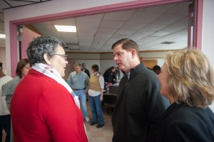 Photo 1: St. Mary's Board of Trustees Chair Katherine Hesse (left) and St. Mary's President Deirdre Houtmeyers (right) with Mayor Marty Walsh during the January 25th visit and volunteer appreciation ceremony.
