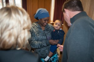 Photo 4:  St. Mary's President Deirdre Houtmeyers (right) and Mayor Marty Walsh (left) with Sahara Wadi and her son, Abdullahi Mohammed. Wadi is a resident at Margaret's House, St. Mary's Emergency Family Shelter.