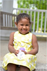 smiling girl in yellow